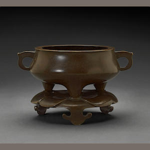 A patinated bronze censer and stand