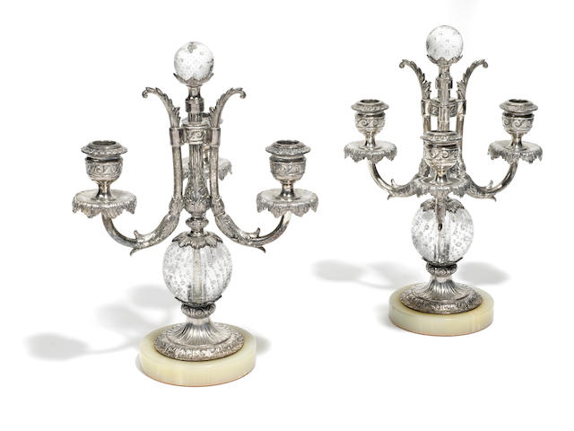 A pair of Pairpoint Neoclassic style silvered metal and glass three light candelabra