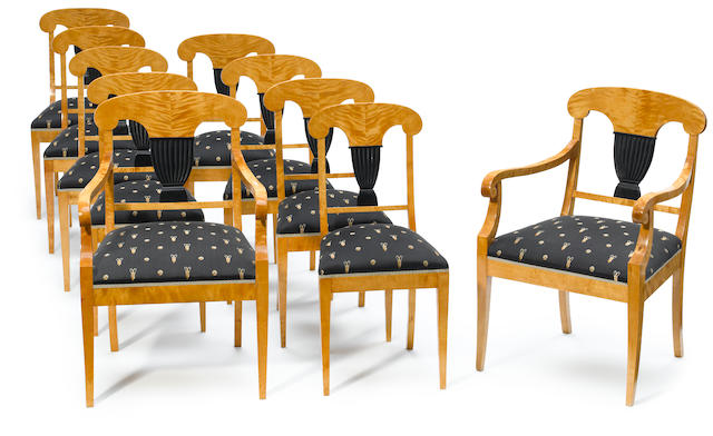 A set of ten Biedermeier parcel-ebonized dining chairs - a few later; made to match