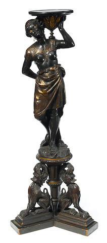 A Venetian Rococo style ebonized figural pedestal