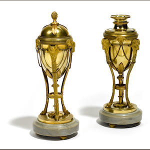 A pair of Louis XVI style gilt bronze and marble cassolettes . 19th century