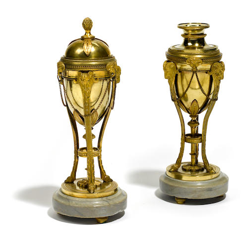 A pair of Louis XVI style gilt bronze and marble cassolettes <BR />19th century