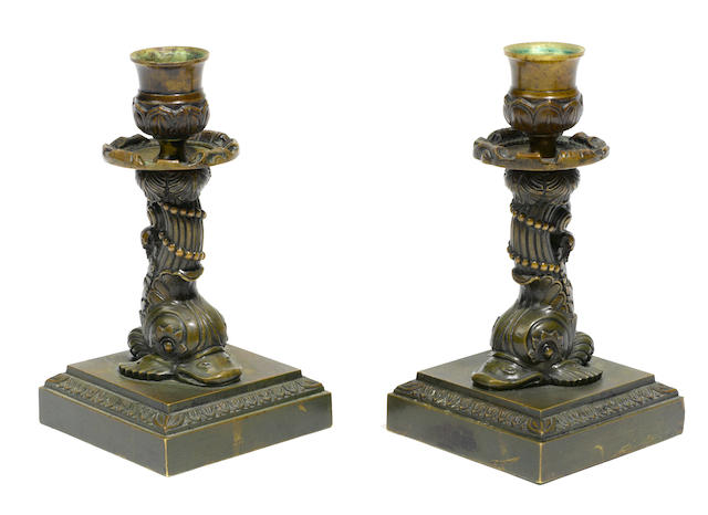 A pair of French patinated bronze candlesticks <BR />first half 19th century