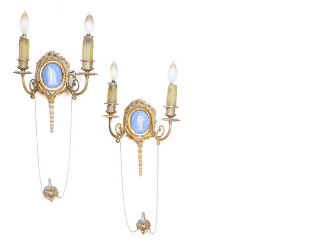 A pair of Neoclassical style silvered metal and jasperware wall lights