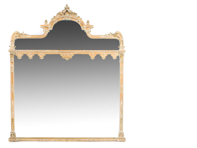 A Neoclassical style carved limed wood mirror