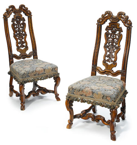 A pair of William and Mary carved walnut side chairs <BR />in the manner of Daniel Marot