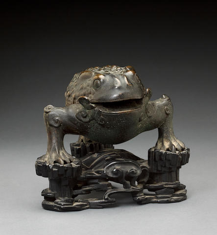 A cast bronze censer in the form of a three-legged toad 18th/19th century