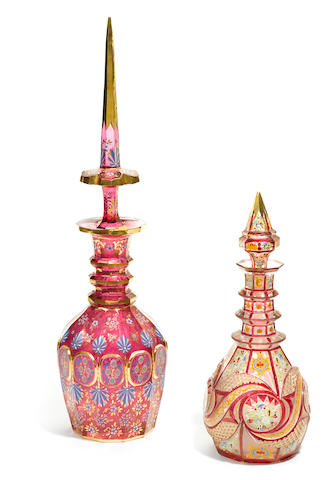 Two Bohemian glass decanters and stoppers