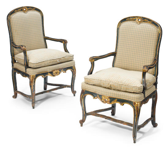 A pair of Italian Rococo parcel gilt and paint decorated armchairs