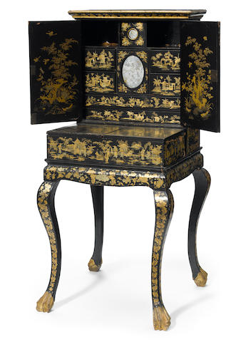 A Chinese Export lacquered and Chinoiserie dressing cabinet <BR />19th century