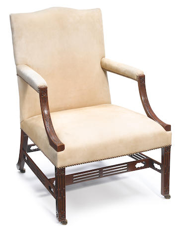 A George III carved mahogany library armchair <BR />fourth 18th century