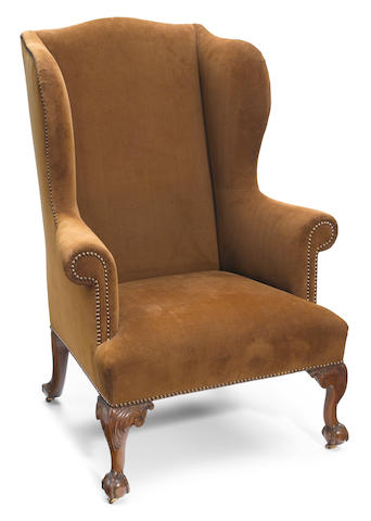 A George III carved mahogany wing armchair <BR />18th century