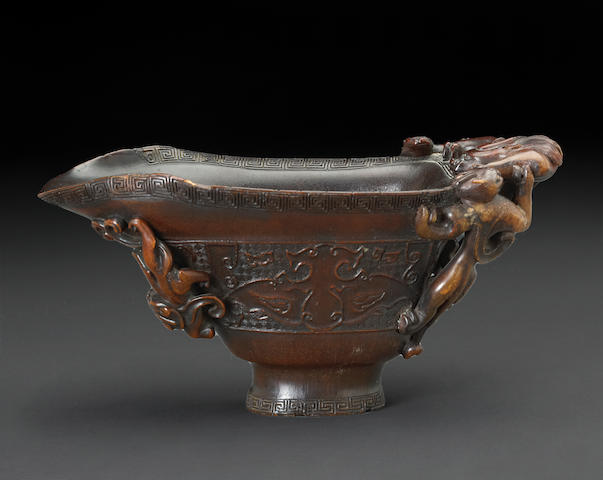 A large archaistic rhinoceros horn libation cup 17th/18th century
