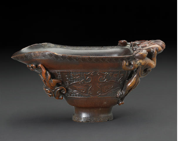 A rhinoceros horn libation cup  18th century (restred handle and rim)