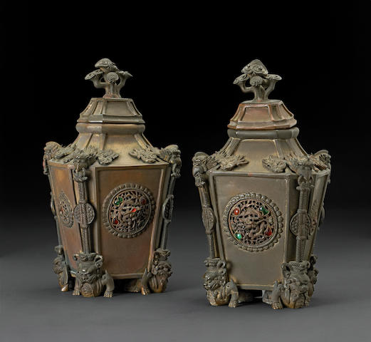 A pair of Chinese pieced cast bronze covered vases of square section with traces of gilt and colored stone inlay on the reticulated panels 18th/19th century