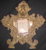 A Neoclassical tapestry panel and a Baroque repoussé brass frame 18th century