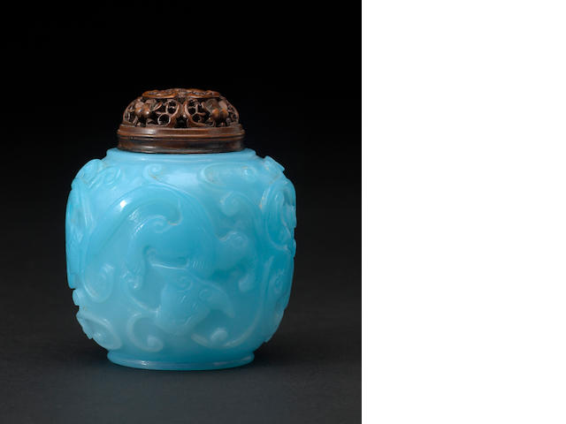 A small turquoise blue jar with a matching carved wood lid Late 18th/19th century
