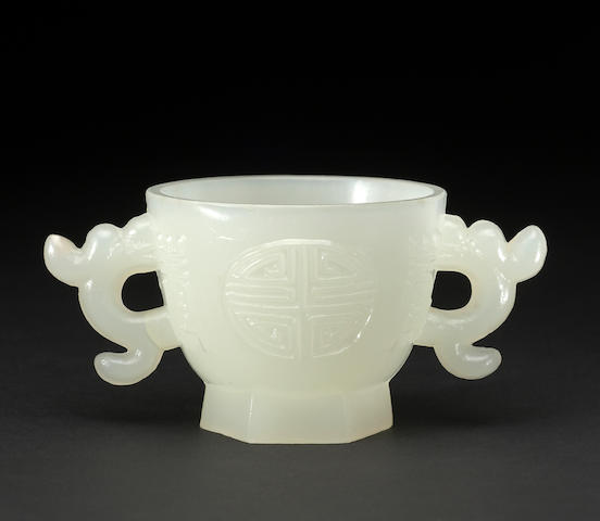 An opalescent white glass handled cup  17th century