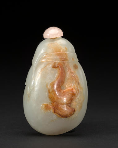 A pebble form jade snuff bottle carved with bat and ribbon with rich russet skin