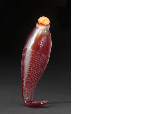 A red overlay glass leaping carp form snuff botlle
