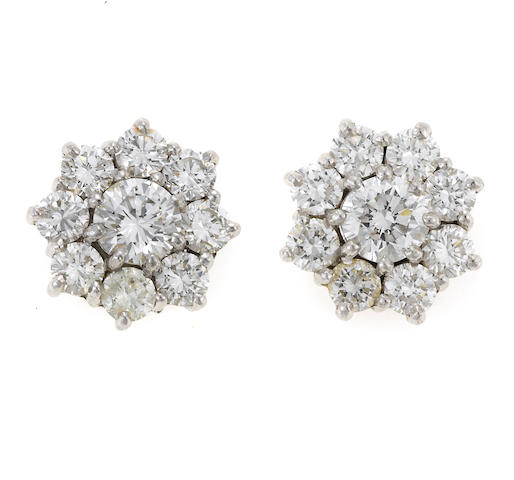 A pair of diamond floret earrings, London