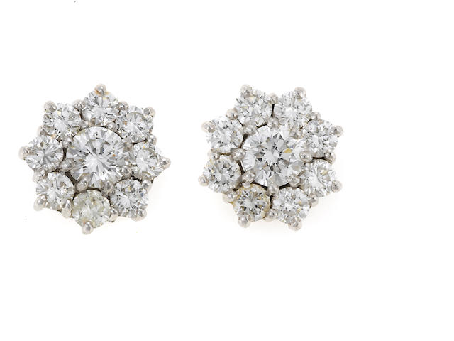 A pair of diamond and white gold floret earrings