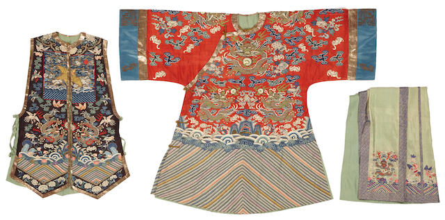 An assembled group of textiles comprised of one vest for an official wife, one red ground dragon robe and one sea green skirt