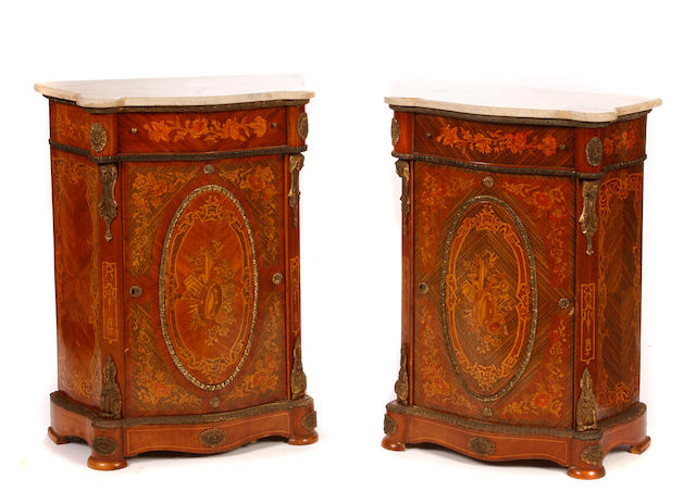 A pair of French gilt metal mounted marquetry inlaid side cupboards
