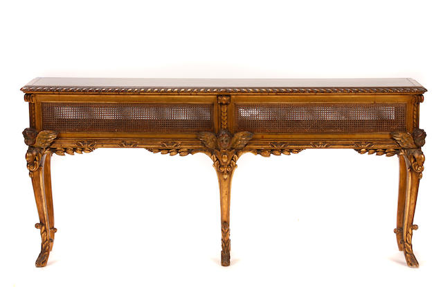 An Italian Rococo style carved giltwood jardinière, mounted as a center table