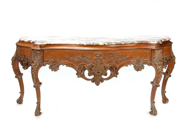 An imposing Louis XV style limed wood console
