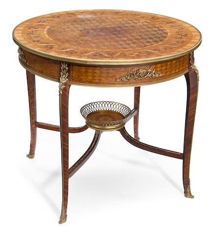 A Louis XV style gilt bronze mounted marquetry and parquetry inlaid kingwood table de milieu  early 20th century