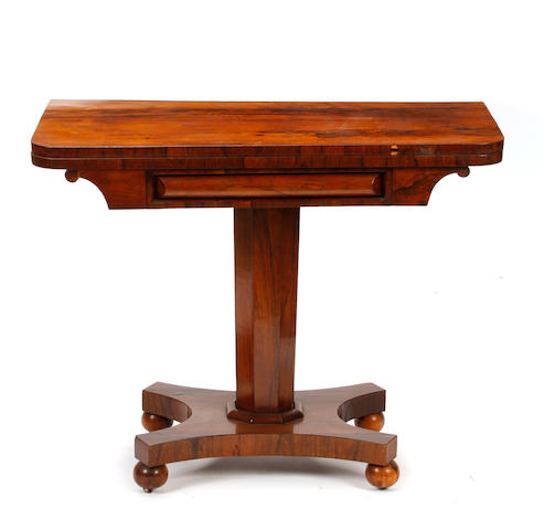 A Regency rosewood pedestal games table