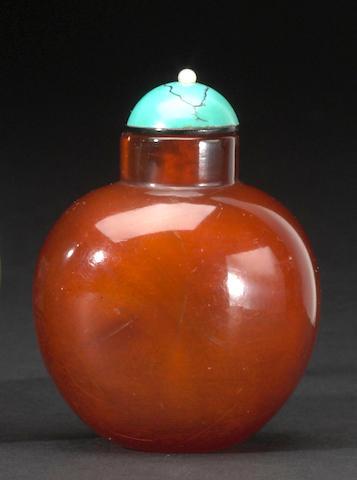 An amber snuff bottle