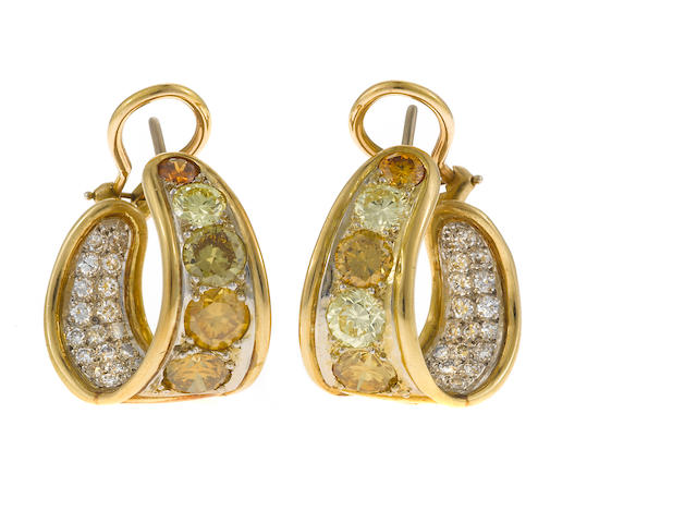 A pair of colored diamond and two-tone gold ear clips (colored diamonds not tested for origin of color)