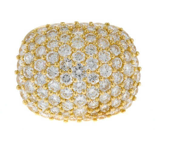 A pavé, round brilliant cut diamond and 18 karat gold dome ring