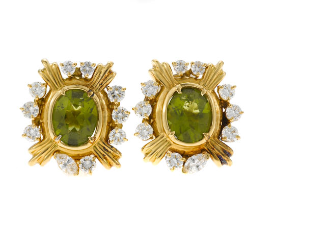 A pair of peridot, marquise and round brilliant cut diamond and 14 karat gold ear clips