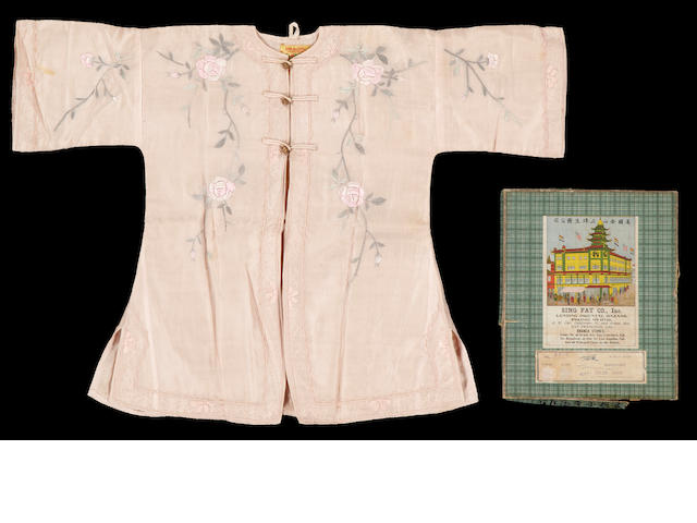 A pink childs robe with original box, purchased 1918