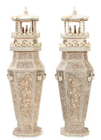 A pair of pierced bone tile floor vases