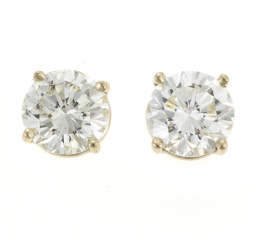 A pair of diamond solitaire earrings (no backs)