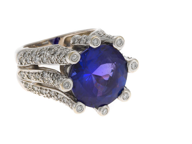 A tanzanite, diamond and 14k gold ring
