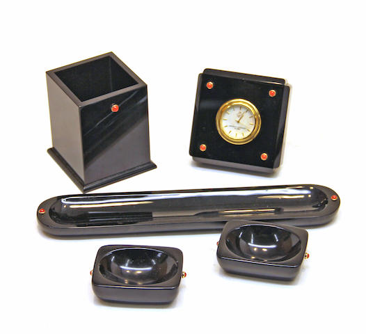 A Seaman Schepps black onyx, gold, and coral cabochon mounted five piece desk set