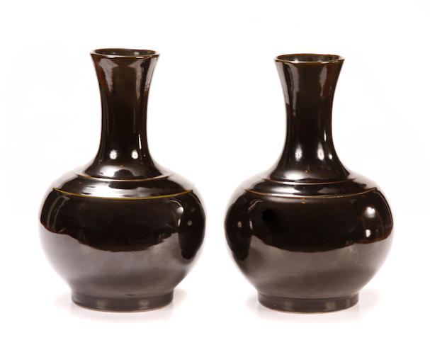A pair of Chinese black glazed vases