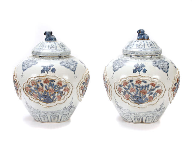 A pair of Chinese paint decorated covered jars