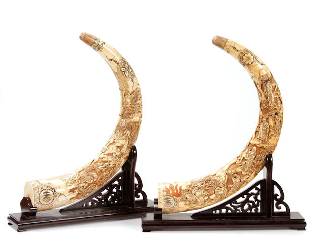 A pair of Chinese bone veneered tusks on stands