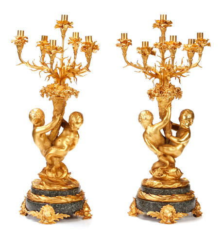 A pair of Louis XV style gilt bronze and marble seven light candelabra