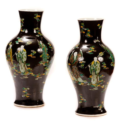 A pair of Chinese famille noire vases