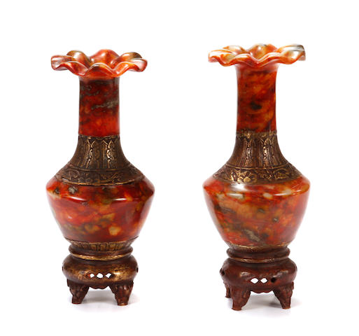 A small pair of bronze mounted carved agate vases