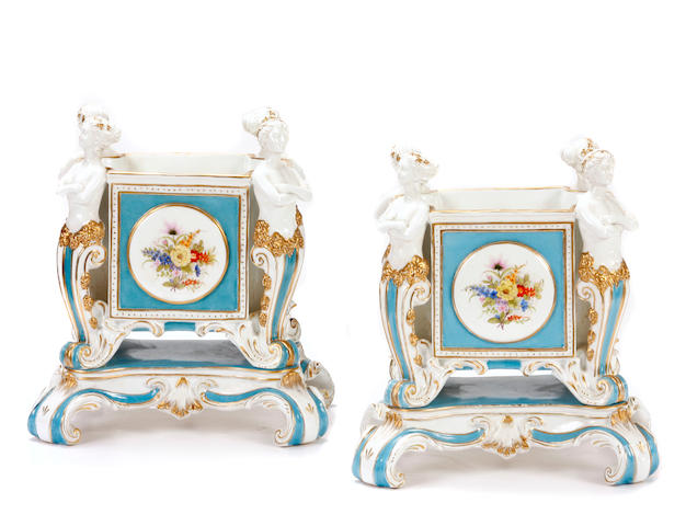 A pair of German Rococo style porcelain figural vases