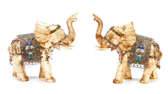 A pair of Chinese jeweled and enameled models of elephants