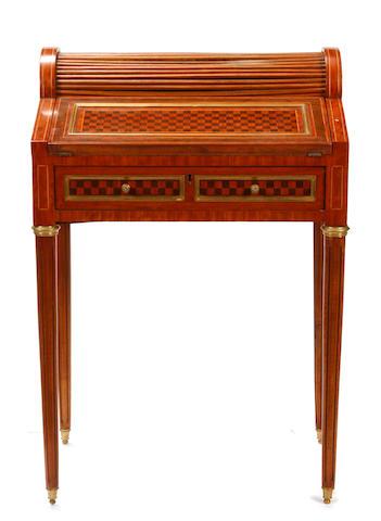 A Louis XVI style gilt metal mounted parquetry tambour desk
